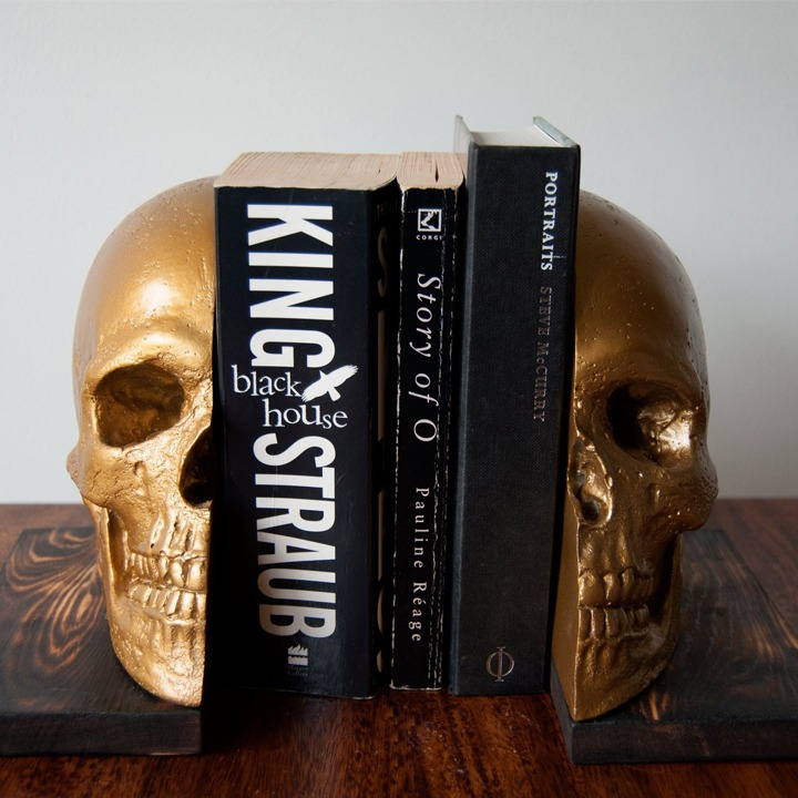 Golden skull bookends