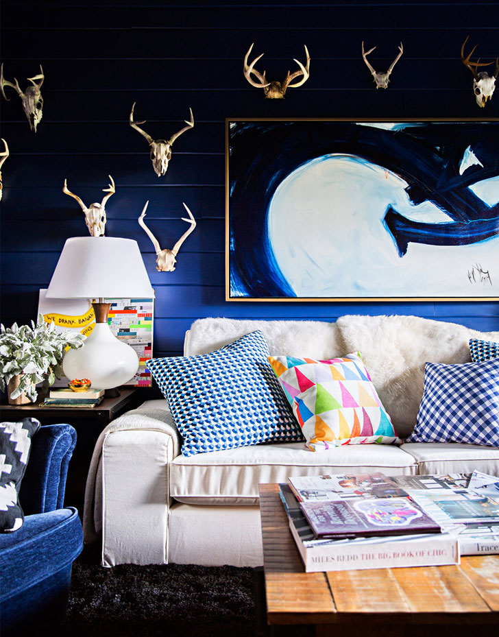 golden deer skulls rich blue living room