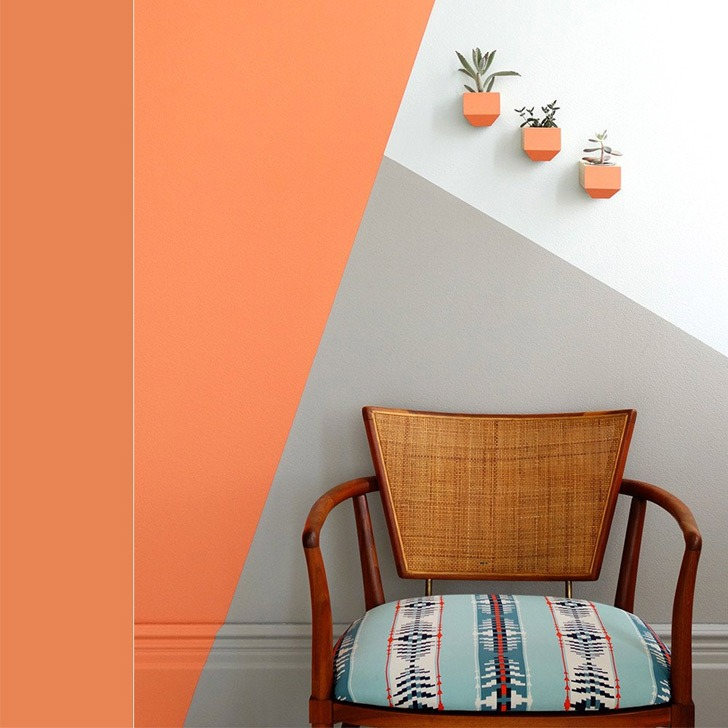 coral geometric accent wall for small space living room