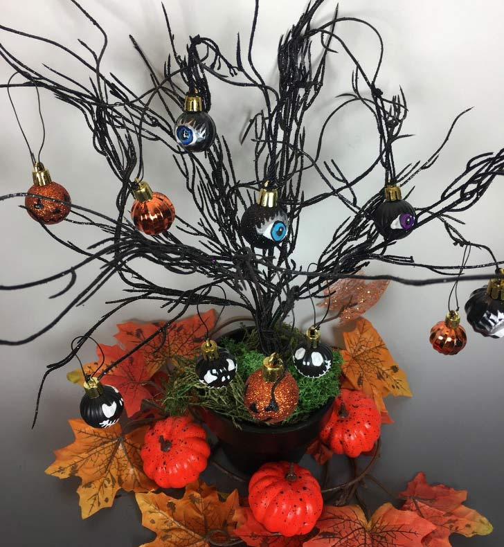 halloween decoration ornaments on branches