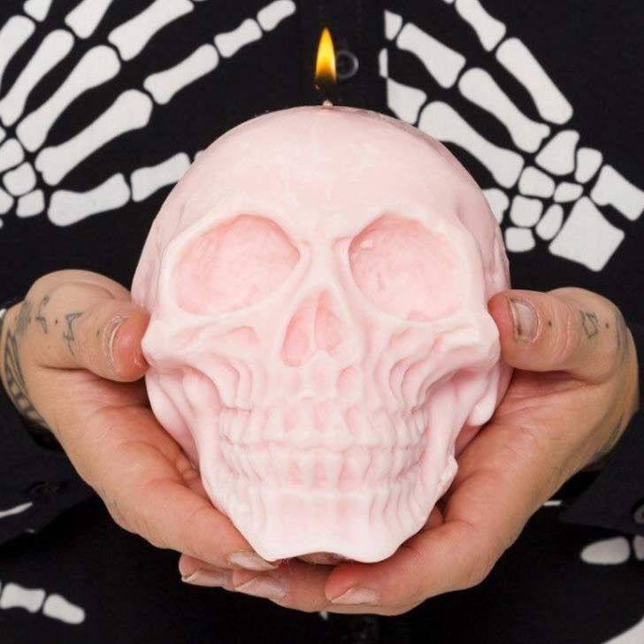 large pastel pink skull candle