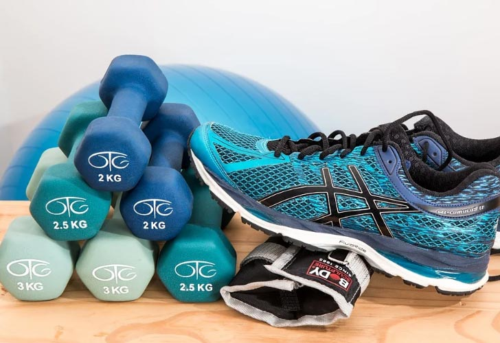 sports footwear and a set of weights