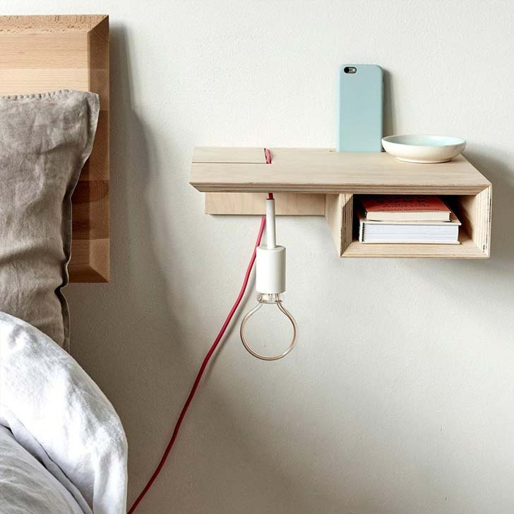 floating bed table with a lamp