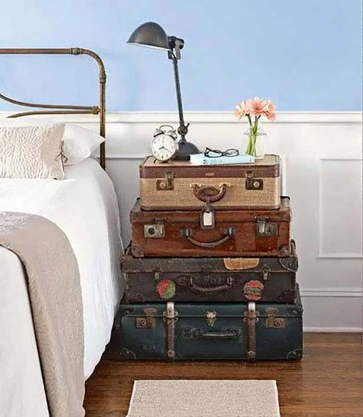 stacked trunks with nightstand essentials