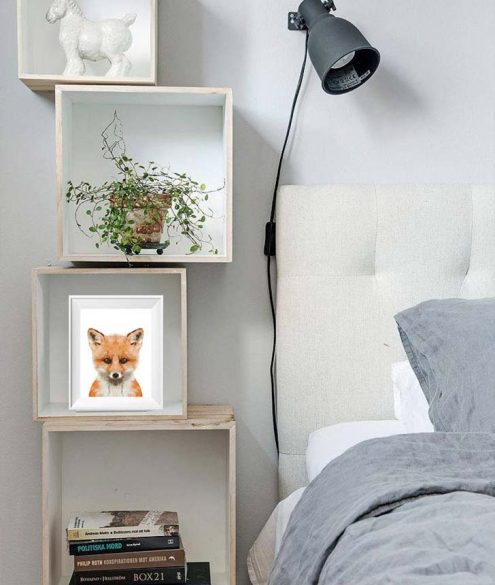 wal-mounted bookshelves by the bedside