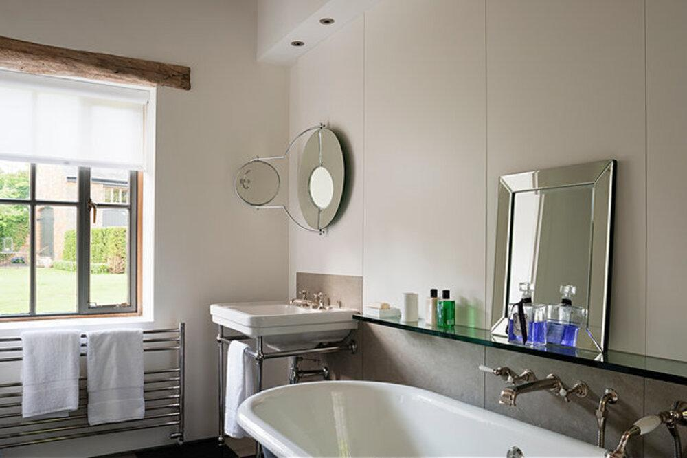 bathroom interior with glass shelves